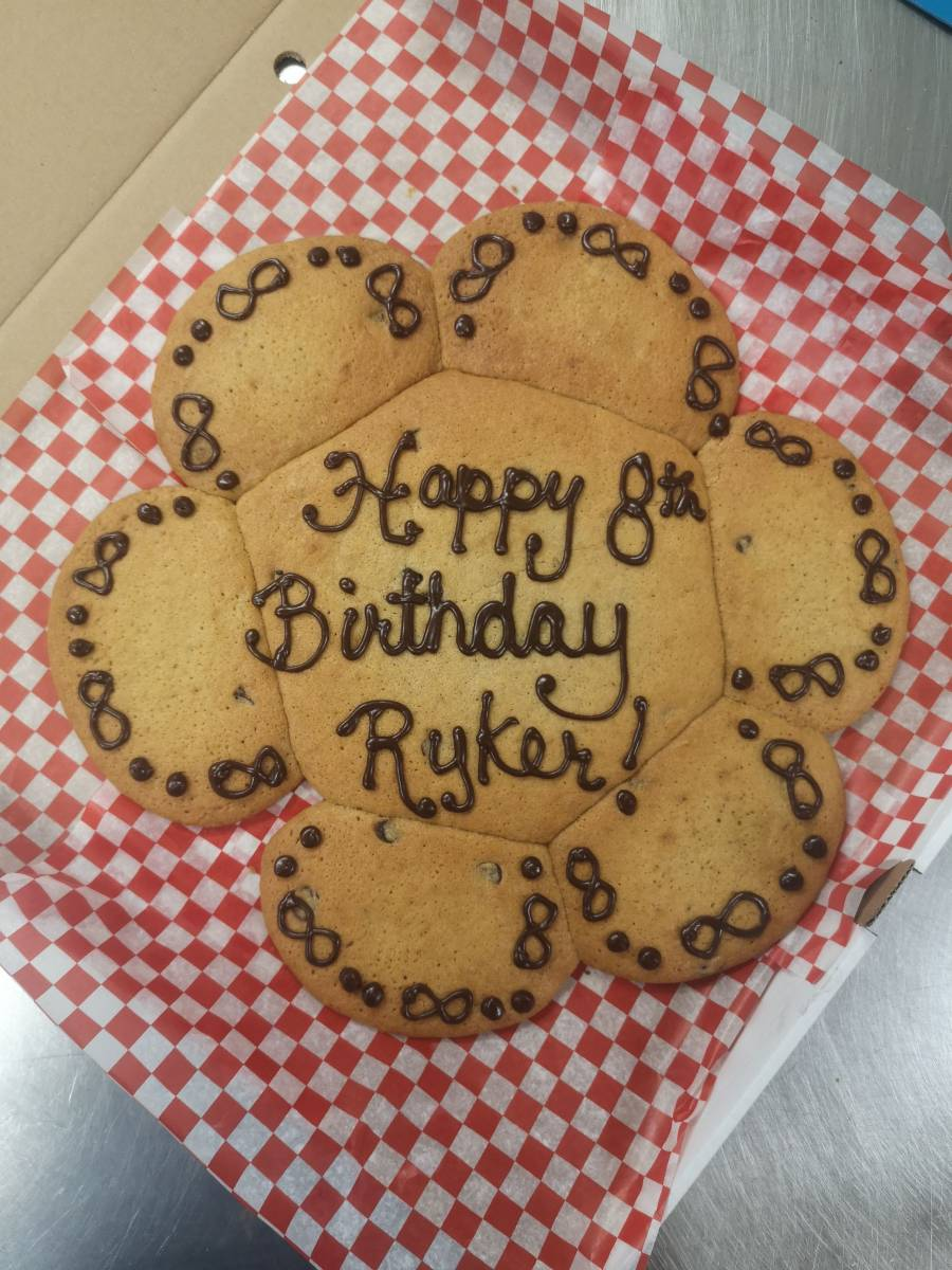 Cookie with happy 8th birthday Ryker written