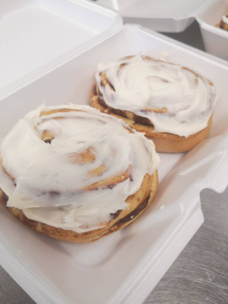 Cinnamon buns with cream cheese on top